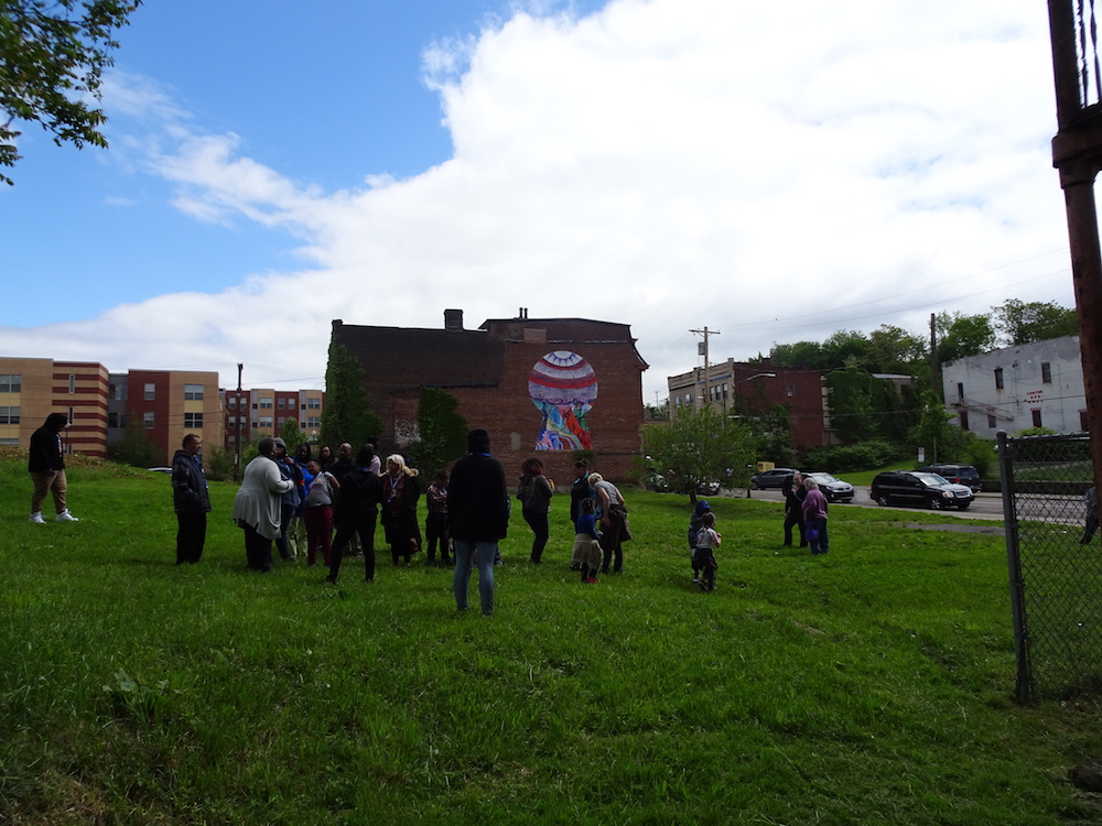 Looking at murals in the Hill District.