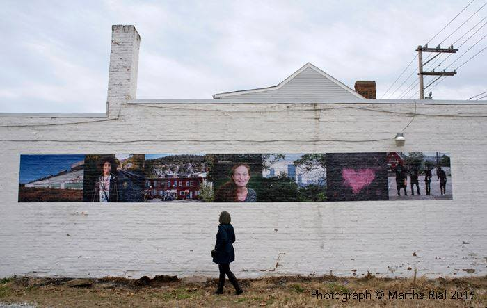 The mural Hazelwood Rising featuring several photos from Hazelwood residents.